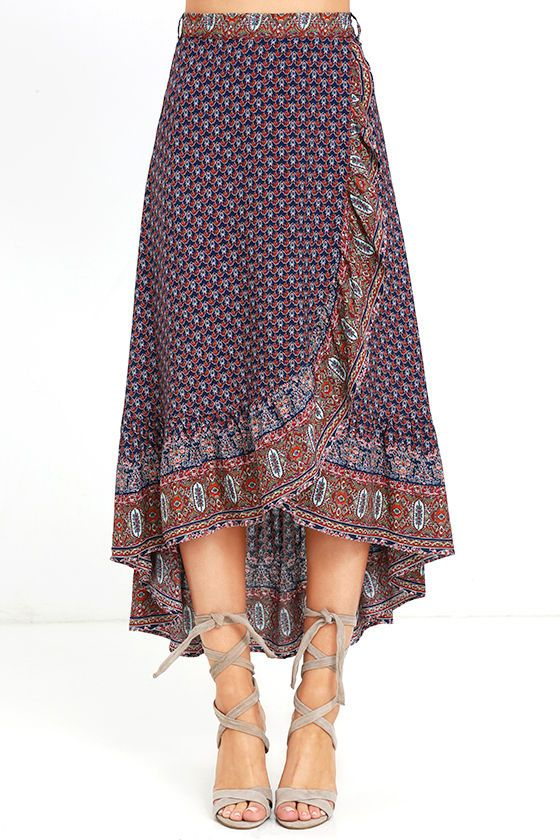 The open road is where the Roaming Nomad Navy Blue Print High-Low Wrap Skirt feels most at home! Navy blue, white, yellow, pink, and orange print creates a mesmerizing look across woven rayon as it falls from a tying waist into a breezy wrap skirt. Ruffled, high-low hem.