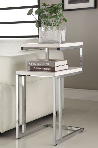 Complete your modern decor with this side table featuring a white and chrome finish. This elegant piece is ideal for use as a phone table, lamp table, decorative display table, or book shelf.