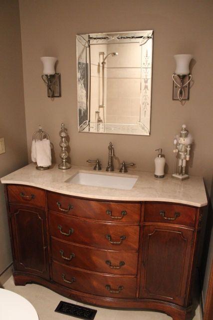 Antique Sideboard used as vanity in guest bathroom