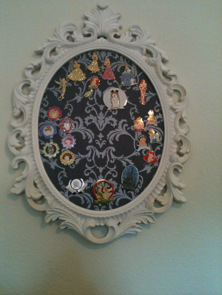 Pins displayed on fabric covered cork board. Or maybe attach pins to ribbon and display in cute frame.