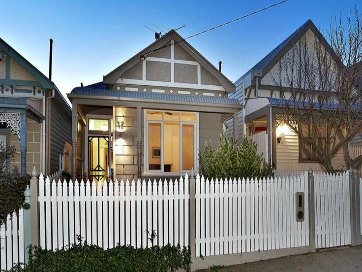 Photo of a corrugated iron edwardian house exterior with picket fence & feature lighting - House Facade photo 129083. Browse hundreds of images of edwardian house exteriors & photos of corrugated iron in facade designs.