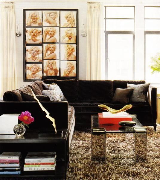 Eclectic living room design with marilyn monroe art for Chocolate brown sofa living room ideas