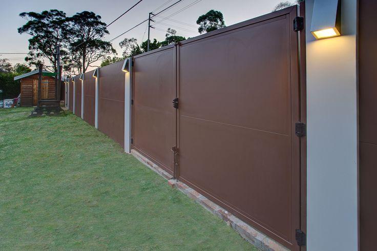 Post mounted lighting along this backyard EstateWall.