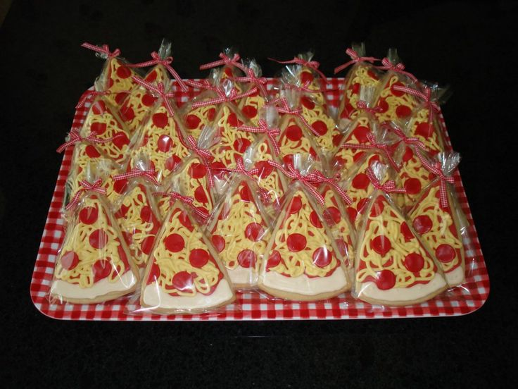 Pizza Cookies - Made as favors to match pizza cakes I did for my neighbor's gir's birthday parties.  NFSC with Antonia4 icing and fondant pepperoni...inspired by Mac.  Thanks for looking!