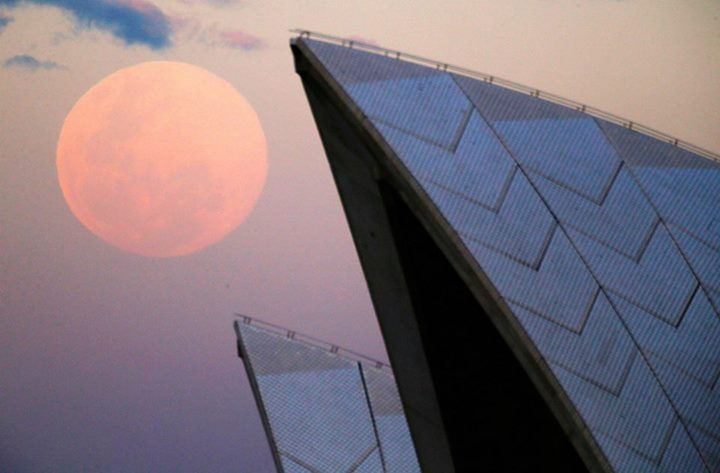 Supermoon and roof of Sydney Opera House.