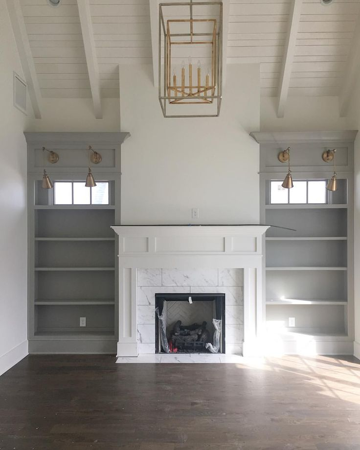 This spec house is almost complete! We are loving how it turned out! #mcfarlandbuilds #thegroveliving #brass #grahamslighting #study #library #fireplace #bookshelves