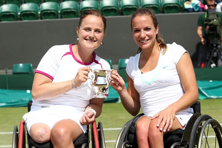 Jiske Griffioen and Aniek Van Koot pose with the trophy after the Ladies' wheelchair doubles final. - Tommy Hindley/AELTC