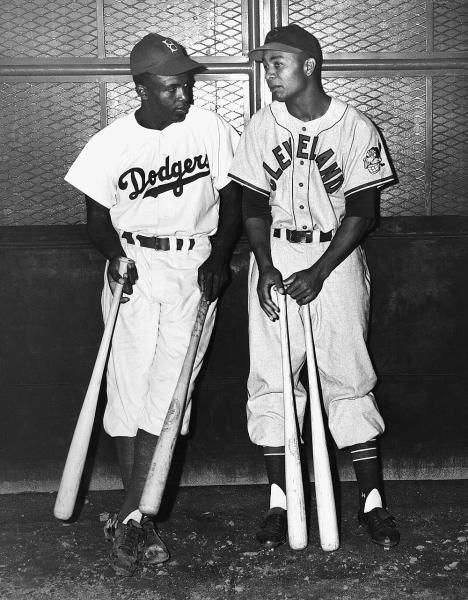 Brooklyn Dodgers infielder Jackie Robinson with Larry Doby in 1947.