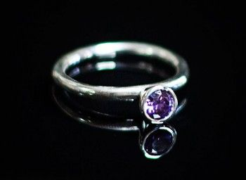A pretty sterling silver ring with an amethyst stone. Wear on its own, or stack with some of our other rings for a striking look.
