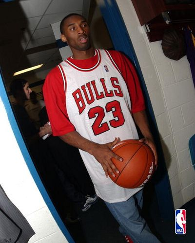 The NBA Superstar that is Kobe Bryant showing the love sporting NBA legend Michael Jordan's famous number 23 Jersey
