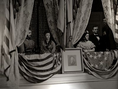 A clever and artful composite of the State Box at Ford's Theatre on April 14, 1865. Major Rathbone on the left with fiance, Clara Harris. Mary and the President sit watching the comedy Our American Cousin while in the dark background, J. Wilkes Booth quietly creeps up from behind to deliver the fatal point blank gunshot to the President's head.  *s*