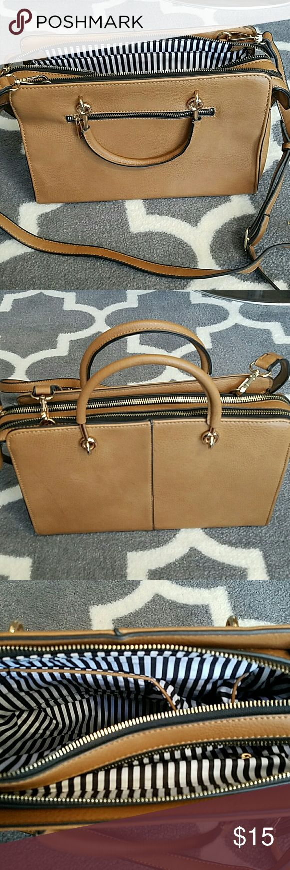 Breifcase Style Structured Handbag Cognac colored synthetic leather bag. Gold hardware and white and black striped interior. Removeable shoulder strap. Excellent condition inside and out. Great bag for work. Bags