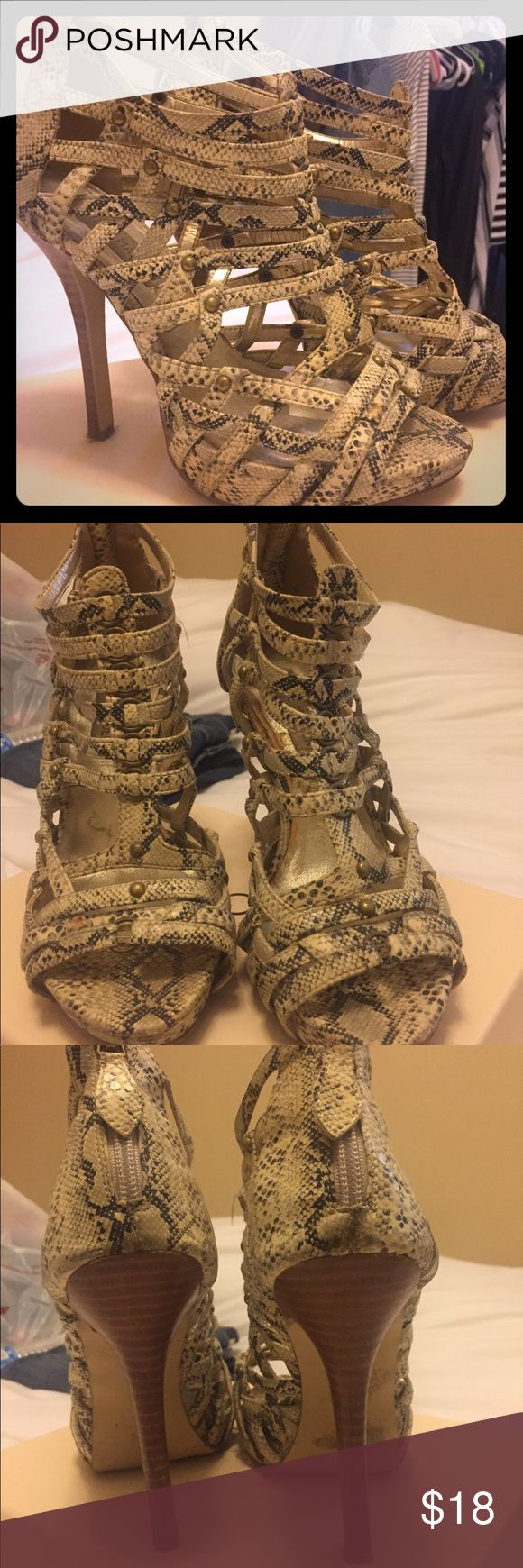 Jessica Simpson snakeskin caged heels Beautiful snake embossed leather caged heel with stacked wooden heels. Slight platform for comfort! Excellent used condition. Steve Madden Shoes Heels