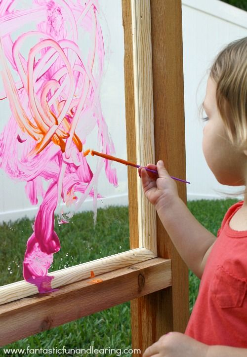 Outdoor Easel-painting on plexiglass mix soap into paint for hose wash or press paper onto painting to save the ones you want, then, hose it off