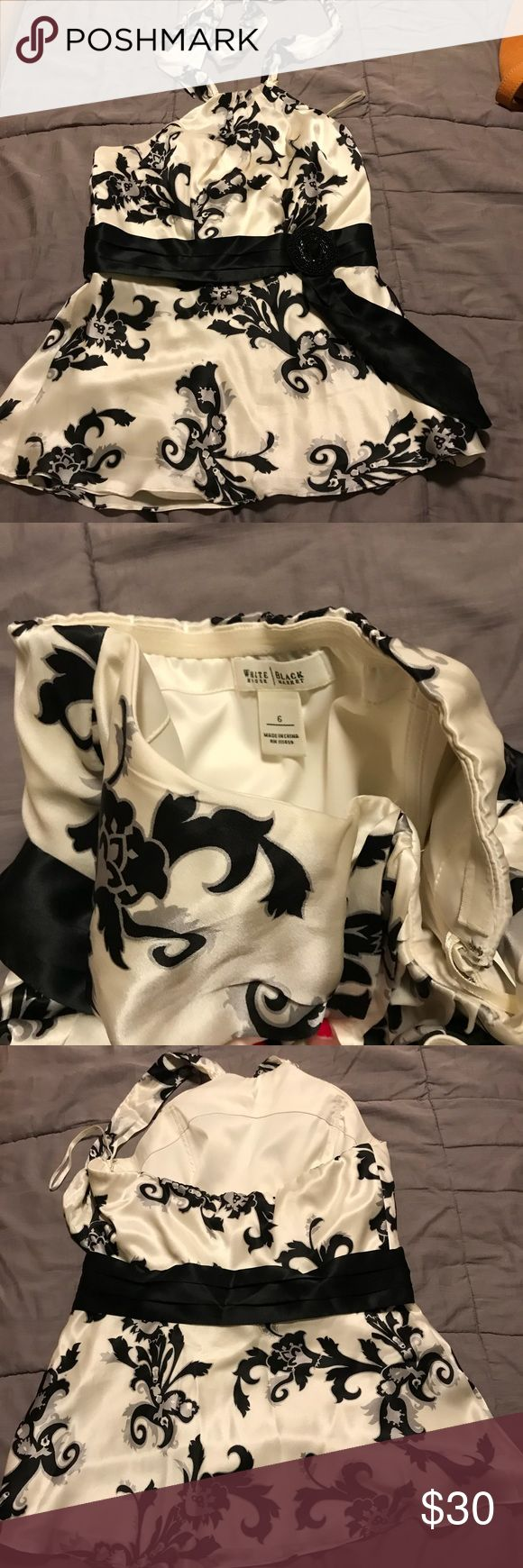 Black house white market Dressy top Black and white dressy top from black house white market. Has  A halter style top with silky material and some underwire lining built in. White House Black Market Tops Blouses