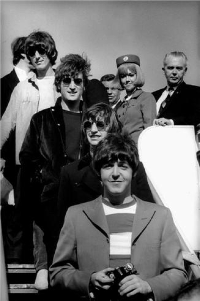 The Beatles coming off the plane for the last concert – SF, 1966 by James Marshall