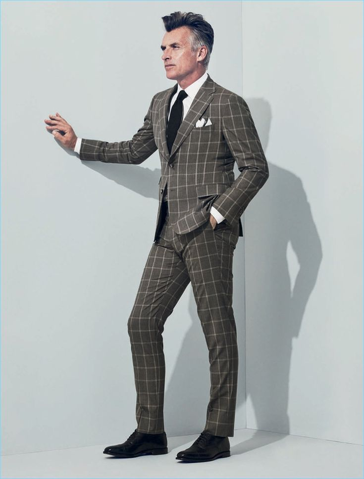 Making a sound sartorial impression, John Pearson wears a J.Hilburn windowpane print suit.