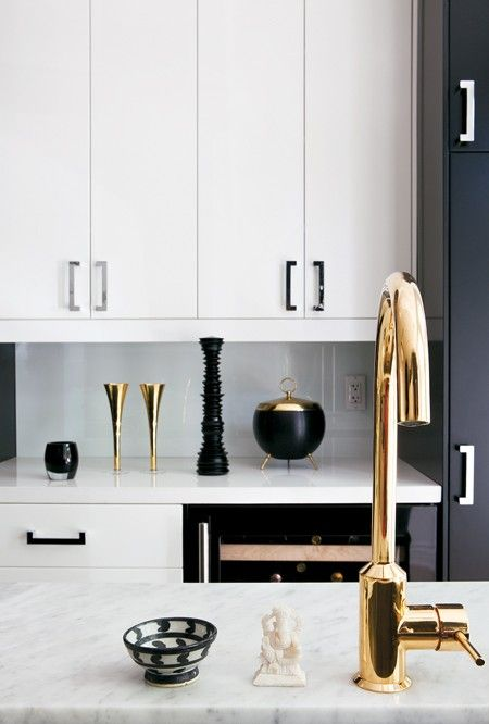 White and black kitchen with a gold faucet  Photo Gallery: Interiors By Lloyd Ralphs Design | House & Home