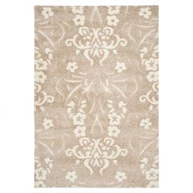"""I like that this is still traditional but not too overwhelming (I love veryyyy traditional.. hubby.. not so much)  Adorned with a damask-inspired motif, this loomed shag rug brings a touch of luxe appeal to your floors.    Product: RugConstruction Material: PolypropyleneColor: Beige and creamFeatures:   Dense shag pileHigh-low pile construction Pile Height:  1""""Note: Please be aware that actual colors may vary from those shown on your screen"""
