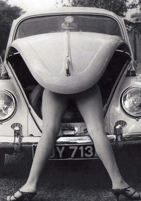 Roger-Viollet - Female legs coming out of the trunk of a Volkswagen Beetle. °