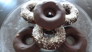 Gluten-Free & (mostly) Paleo Recipes: BAKED CHOCOLATE DONUTS     2 medium green-tipped bananas (approx. 2 cups pureed)      1/2 c. cocoa powder     1/2 c coconut milk     1 tsp vanilla extract     1 tsp cinnamon     1/2 c. coconut flour     3/4 tsp baking soda     1/2 tsp sea salt     1 Tbsp. coconut oil, melted     1 c. Enjoy chocolate chips (optional)     Unsweetened coconut (optional)
