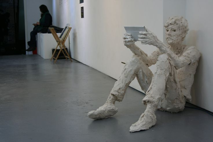 Exhibition: life-size plaster sculpture with tablet
