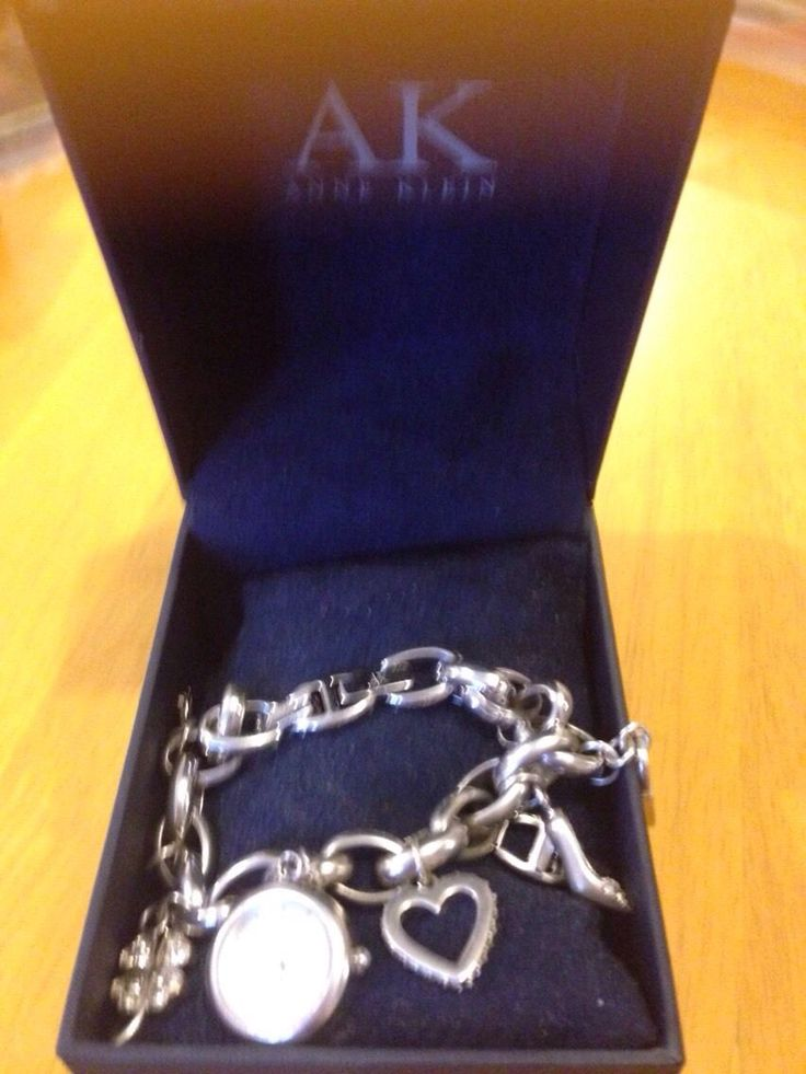 NICE Anne Klein bracelet with click shoe four leaf clover shoe handbag key heart and Ak charms as New comes in gift box worn once