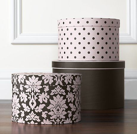 I use hat boxes for my nail polishes, hair stuff and make-up. It's an inexpensive way to also add a pop of colour to my bathroom.