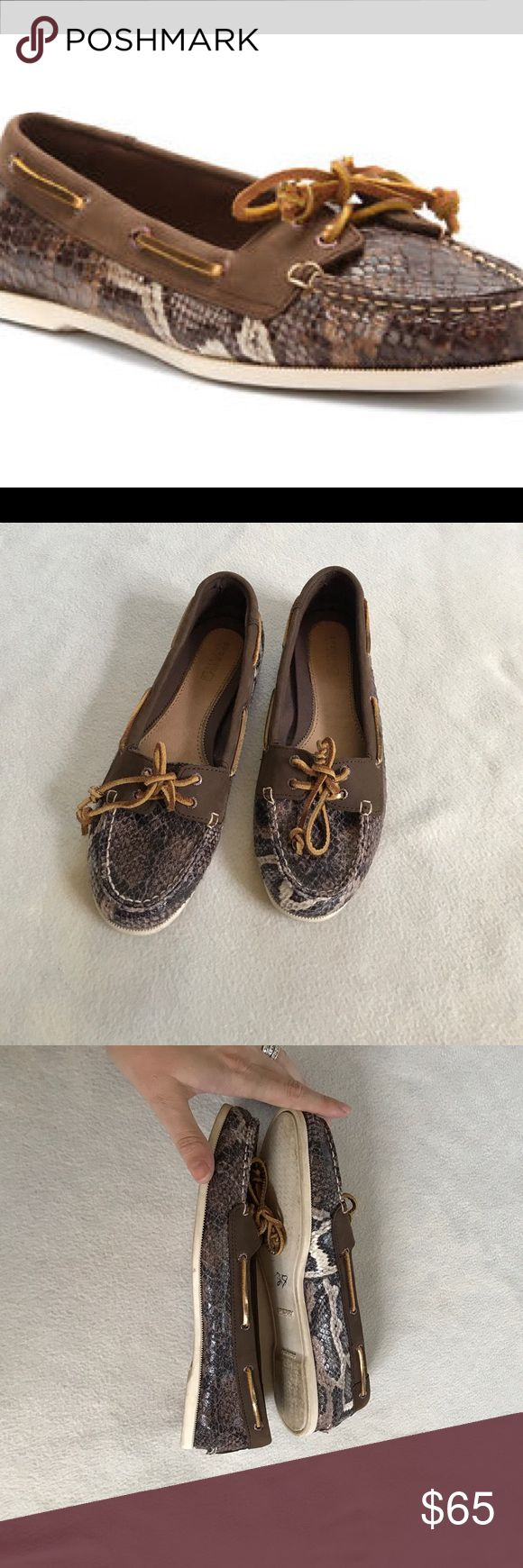 Sperry Audrey Brown Python Pattern Boat Shoe Is a brown pattern with a hint of black. Snakeskin. Has brown accent on top. Ties. Bottom just a tad dirty. Clean inside. Bundle 2+ items for a discount. Sperry Top-Sider Shoes Flats & Loafers