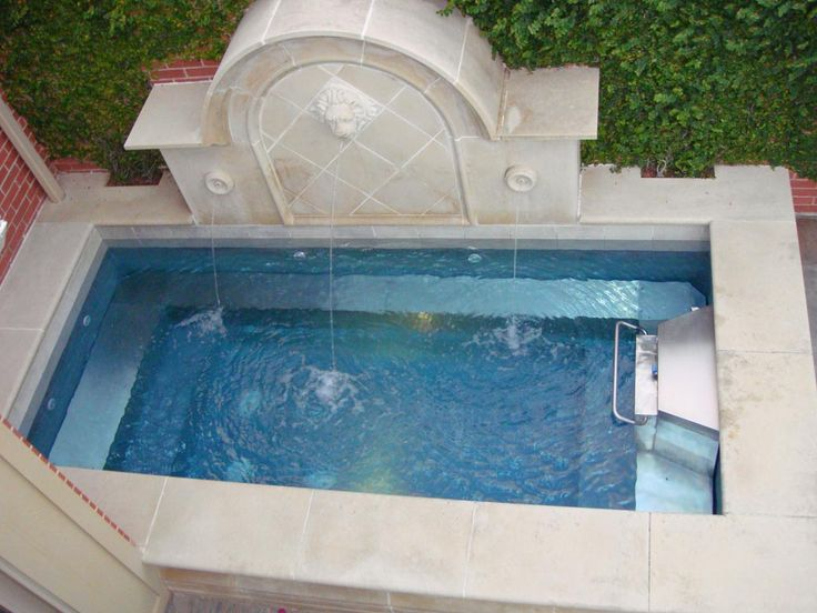 Swimming Pool Fountain Ideas find this pin and more on pools waterfall Swim In Place Pool Incorporating A Fountain