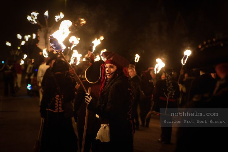 A torchlight procession during bonfire night in West Sussex. Photo © Scott Ramsey / nothhelm.com