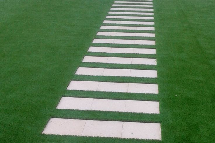 Check out how well this artificial grass works surrounding these pavers in Dubai.