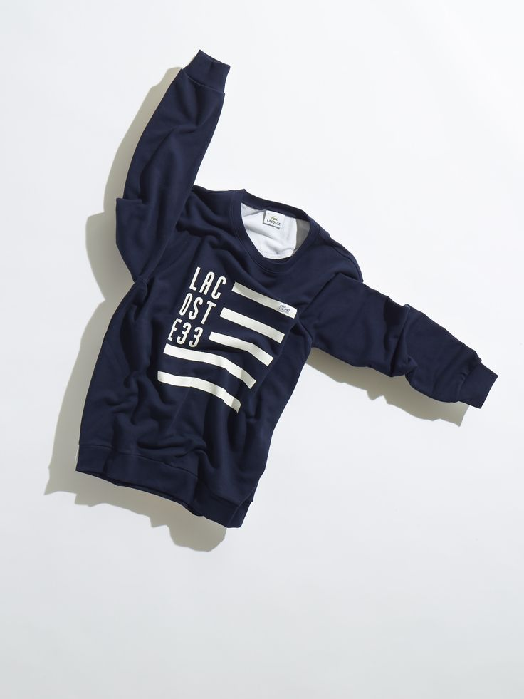A graphic flag waves from this blue sweatshirt in soft cotton fleece.