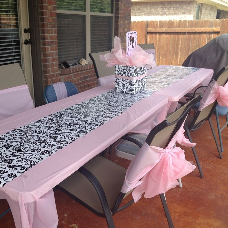 Wrapping paper as table runner & extra tablecloths as chair ties