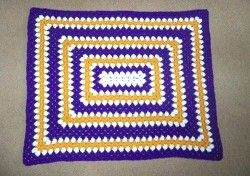 Give the gift of a Rectangle Granny Square Baby Blanket Pattern!  This easy crochet pattern is both gorgeous and budget-friendly.