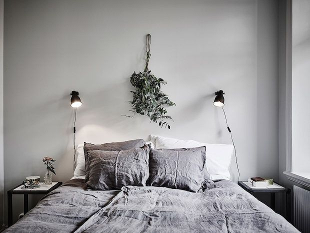Linen bedding and grey walls in a beautiful Swedish home in calm, muted tones. Entrance, Anders Bergstedt.
