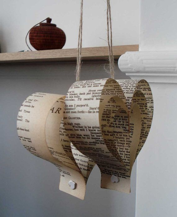 A set of 10 paper heart wedding decorations created using upcycled Shakespeare book pages. A pretty and delicate wedding decoration - to give a literary