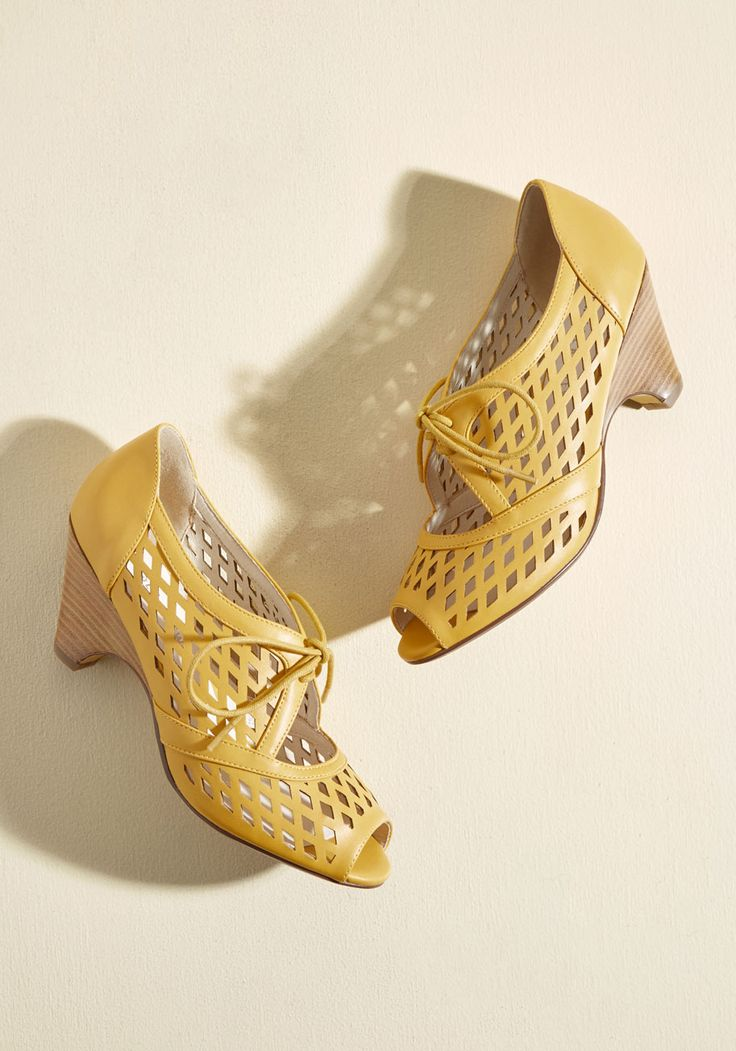 Perf Your While Heel in Mustard. These goldenrod peep toes by Chelsea Crewfind themselves to be worthy of your time, so why don't you give 'em a go? #yellow #modcloth