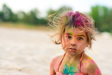 Cute young little girl smiling with colorful body