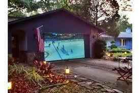 Watch Movies-Home Theater Projector-Ouside on Garage Door