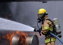 US Navy 080730-N-5277R-003 A Commander, Naval Forces Japan firefighter douses a fire on a dummy aircraft during the annual off-station mishap drill at Naval Support Facility Kamiseya.jpg
