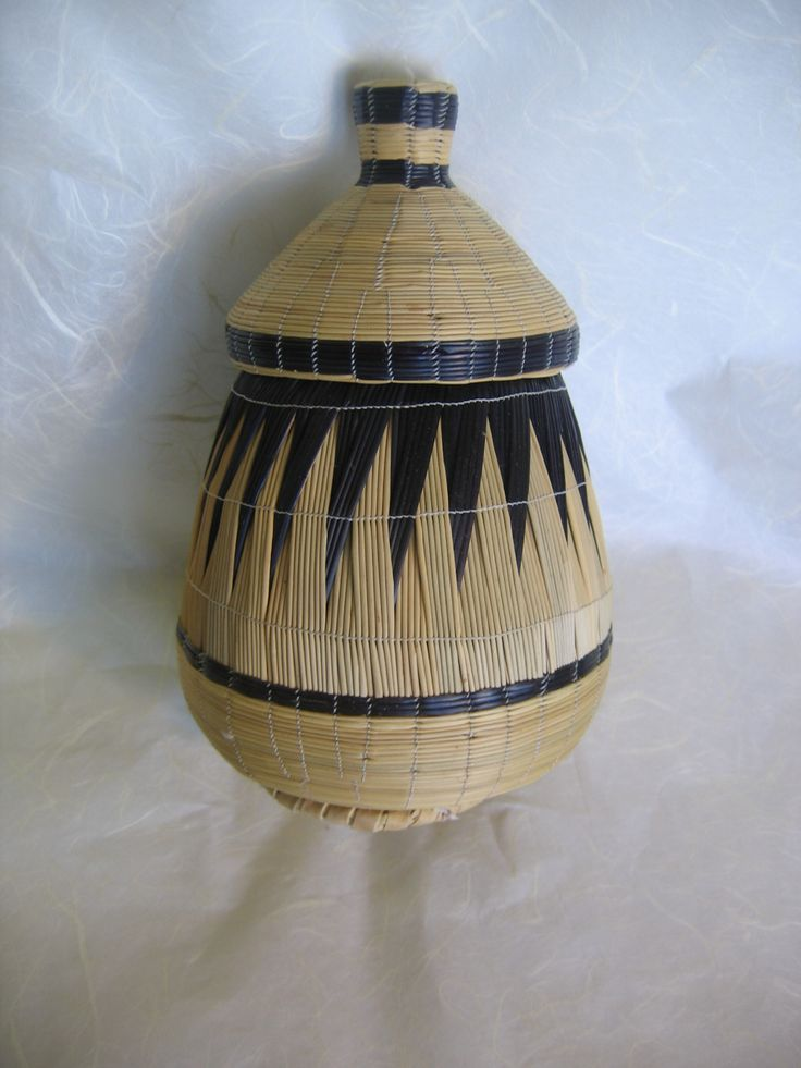 """Once used as containers to carry food and transport goods or as decorations during weddings and baby christenings, these traditional, lidded baskets have been dubbed """"peace baskets"""", because of the role they've played in bringing women of different ethnicities together in the wake of the 1994 genocide."""