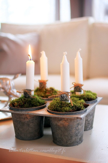 so pretty - use old baking tins to hold candles and moss.