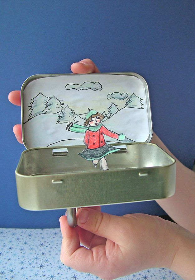 """Ice-skating rink from an Altoids tin: You can make this cute, little, portable toy, using only a magnet, a paperclip, an empty altoid tin, and some basic drawing skills! Check out this tutorial, and other fun ideas on """"small world land""""."""
