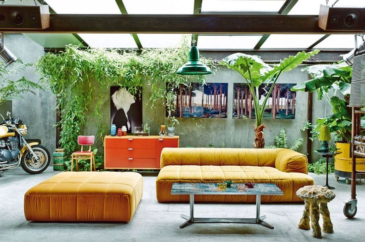 interior-design-living-room-style-eclectic,-vintage,-industrial,-Backyard-with-plenty-of-greenery-and-interesting-yellow-couch-accompanied-Sloping-Ceiling-that-matches the-relaxed-atmosphere