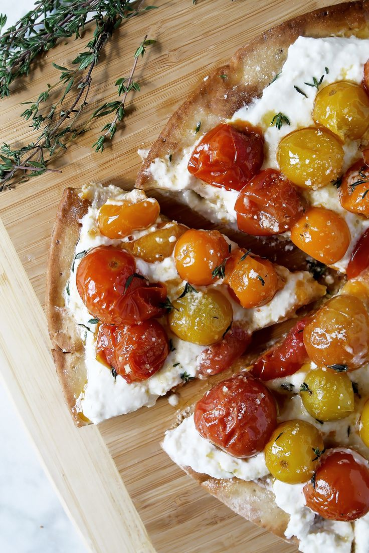 Our Whipped Feta and Roasted Cherry Tomato Pizza is the perfect way to get your fresh Italian pizza pie fix, healthfully! With whipped feta and parmesan topped with herbs, roasted tomatoes, and a gluten free or whole wheat crust, this recipe just hits the spot! It's so fresh, healthy, optional gluten free, and requires no sauce! Not looking for pizza? Try making it as bruschetta instead! So easy and delish, enjoy! :)