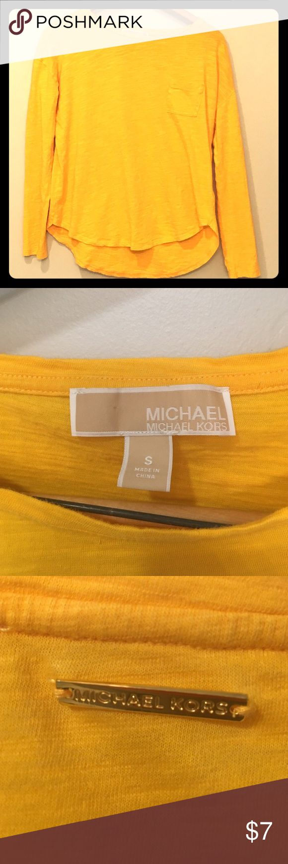Michael Kors gold pocket t-shirt Michael Kors long sleeve pocket t-shirt. Simple and bright. The gold Michael Kors label in the back has caused a very tiny hole that cannot be seen when worn. Michael Kors Tops Tees - Long Sleeve