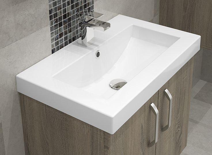 Bardolino Oak Modular Bathroom Furniture - Our crisp white sanitaryware complements Bardolino Oak perfectly. This sit-on basin is the ideal match, with its smooth lines and contemporary design.