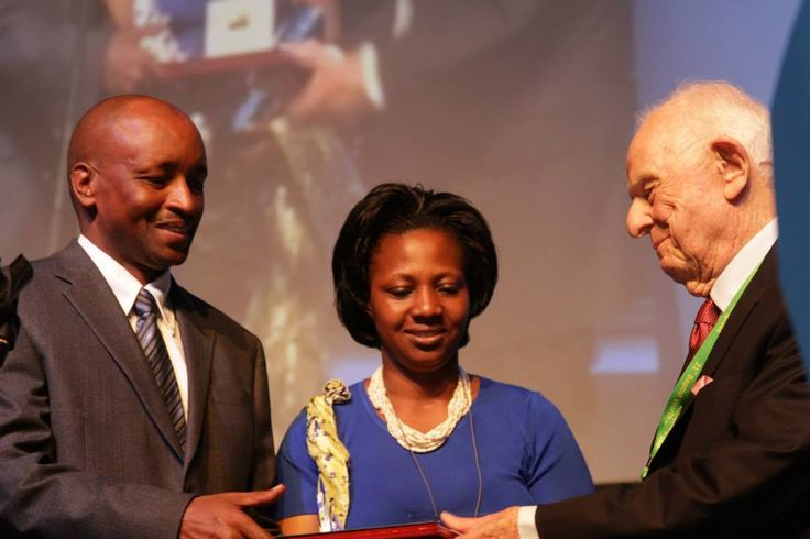 Mr. and Mrs. Corneille Gato Munyamasoko receive the BWA's human rights award from David Maddox during the 2015 World Congress in Durban. Photo by Cliff Vaughn.