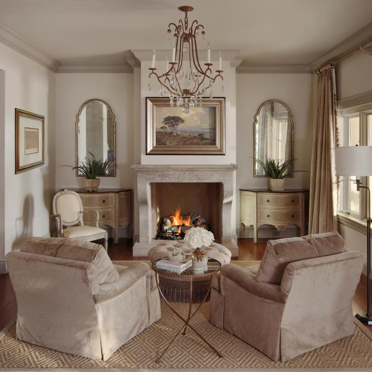 A sense of symmetry brings out the natural beauty in the sitting room. On either side of the fireplace, distressed demilune consoles and stylized mirrors have an old but new quality. The ceiling is a few shades darker than the walls, which adds a coziness to the elegant space.